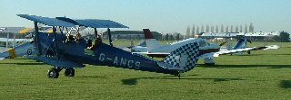 Tiger Moth G-ANCS taxis past